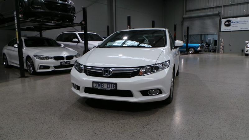 2014 Honda Civic 9th Gen Ser II MY15 VTi-L Sedan 4dr Spts Auto 5sp 1.8i